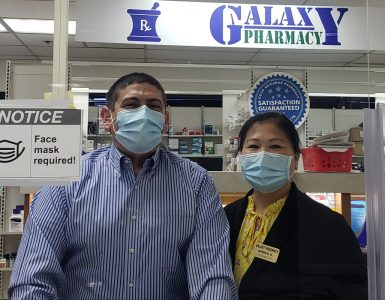 Pharmacists Karl and Amber Hess standing in pharmacy.