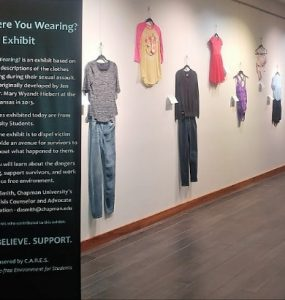 """Exhibition called """"What Were You Wearing"""" displayed on walls in Argyros Forum"""