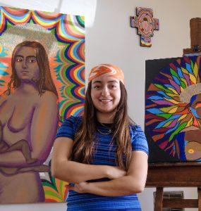 Natalia Ventura '21 poses with her artwork