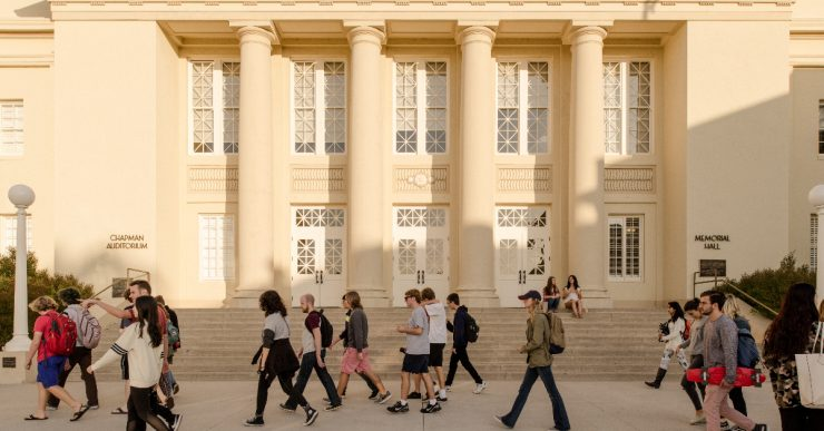 Students walking in front of Memorial Hall.