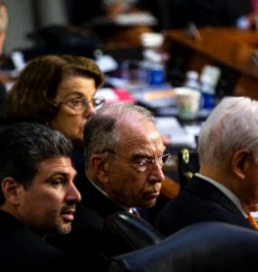 Chapman and Fowler Law graduate Joshua Flynn-Brown with Sen. Chuck Grassley in a Senate hearing.