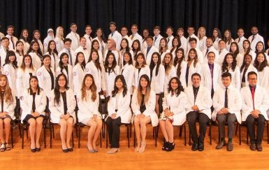 The class of 2021 and the Dean at their White Coat Ceremony in September 2018.