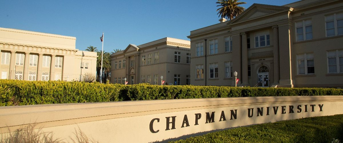 View of Chapman University sign and Memorial Hall.