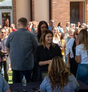 Staff gathered together outside of Musco Center for the Arts.