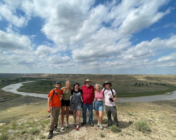 Gathered near the Montana dig site are Ghen Raz, Lila Motley, Casey Hoerman , Presidential Fellow and paleontologist Jack Horner, Sarah Wallace '22 and Ben Tuschman '21.