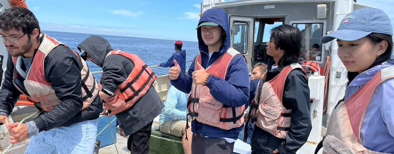 Peter Ly on a research boat off the coast of Appledore Island, Maine