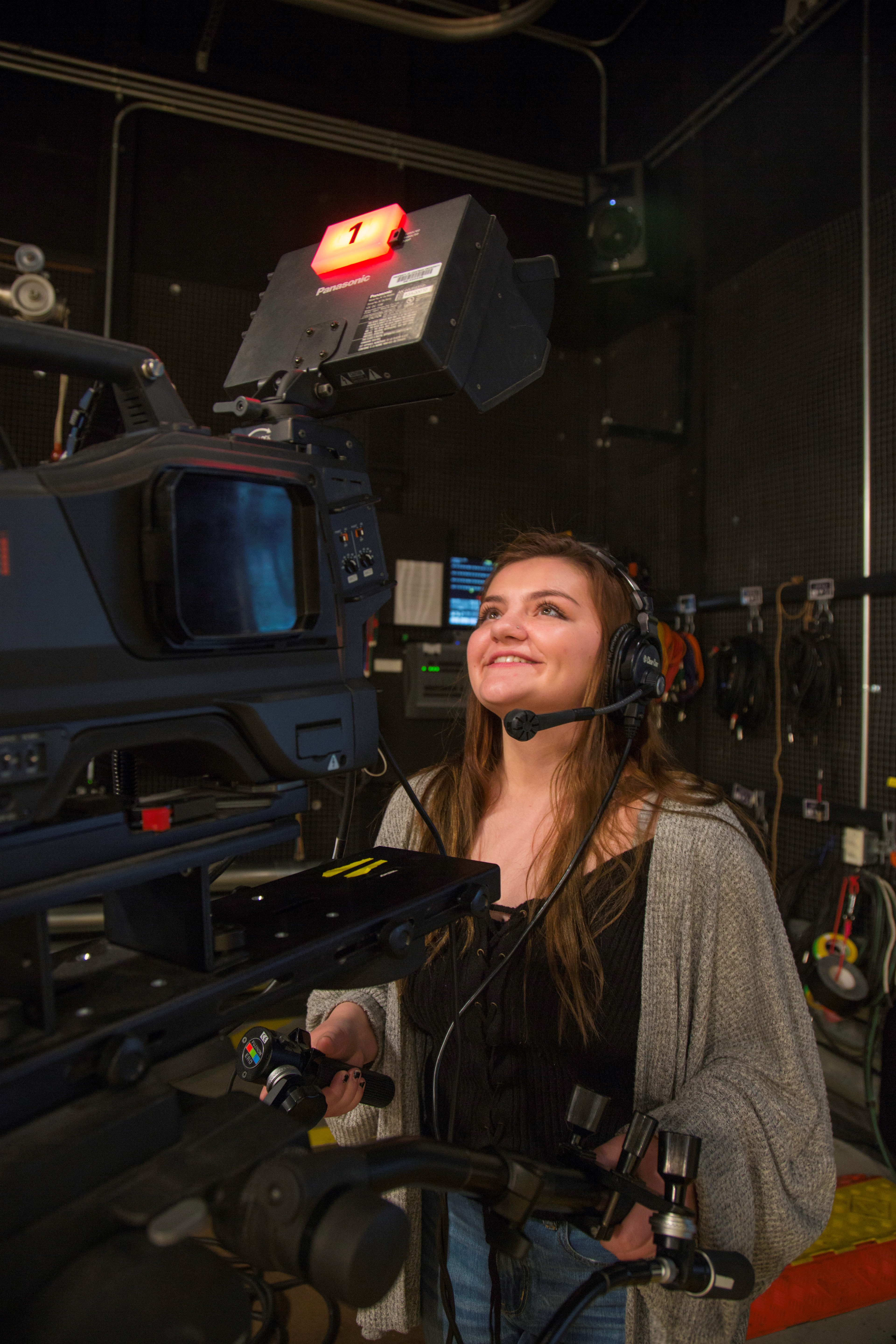 Female Dodge College student behind the camera.