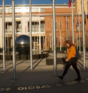 Chapman student walking throught Global Citizens Plaza
