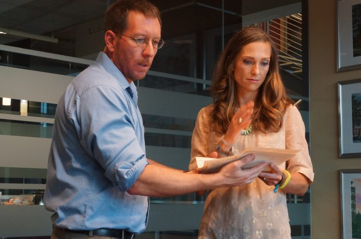 Chapman University Presidential Fellow Andrew Carroll receives Anna Miller's handwritten recollection of her experience at Ground Zero on 9/11.