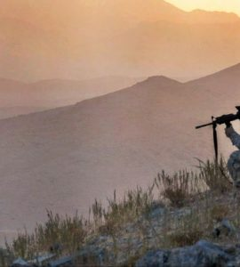 U.S. Army Spc. Jason Hebert provides security in the early dawn during an air assault mission above in Zabul province, Afghanistan, 2009. (U.S. Army photo by Spc. Tia P. Sokimson)