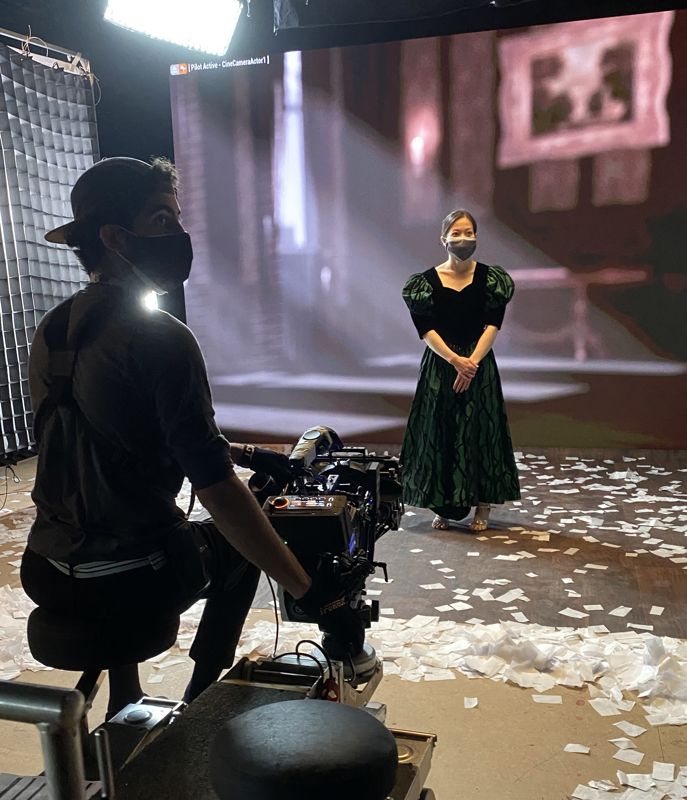A ballroom dancer waits for her scene, at the new LED virtual production wall in the Digital Media Arts Center, which combines live-action and digital filmmaking