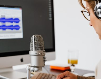 Woman records audio.