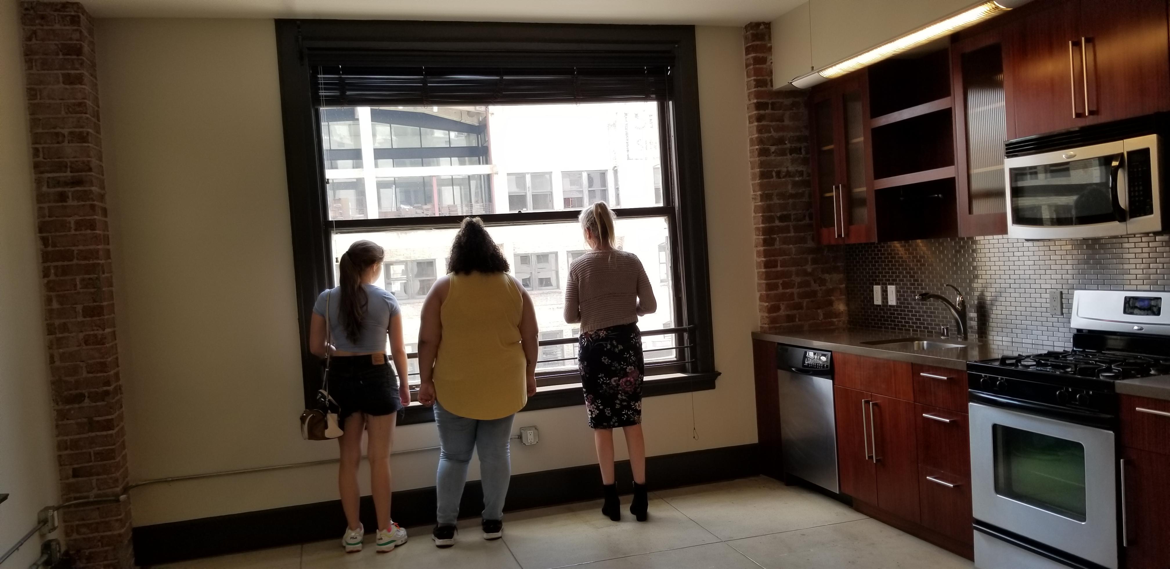 Students inside Chapman Flats apartment.