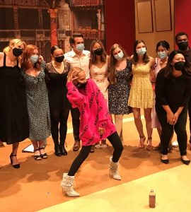 Actor Kristin Chenoweth on stage posing with Chapman students